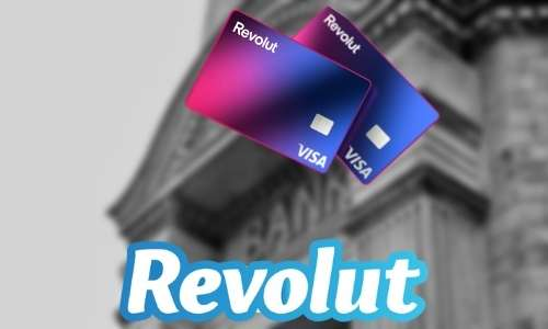 A bank in background with the logo revolt and a couple of credit cards